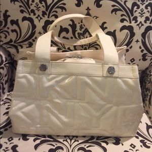DKNY off white patent leather like new